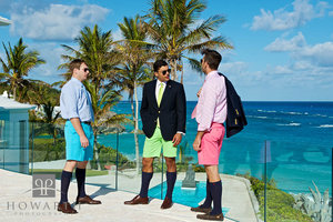 Bermuda shorts, jacket, knee socks, young, professional, pink, green, blue, tie, conversation, bright, color, glass balcony, pool, buddha, ocean