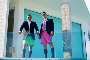 Bermuda shorts, jacket, knee socks, young, professional, smiling, glass balcony, pink, green, bright, color