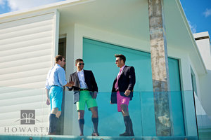 Bermuda shorts, jacket, knee socks, young, professional, smiling, glass balcony, hand shake, pink, green, blue, bright, color