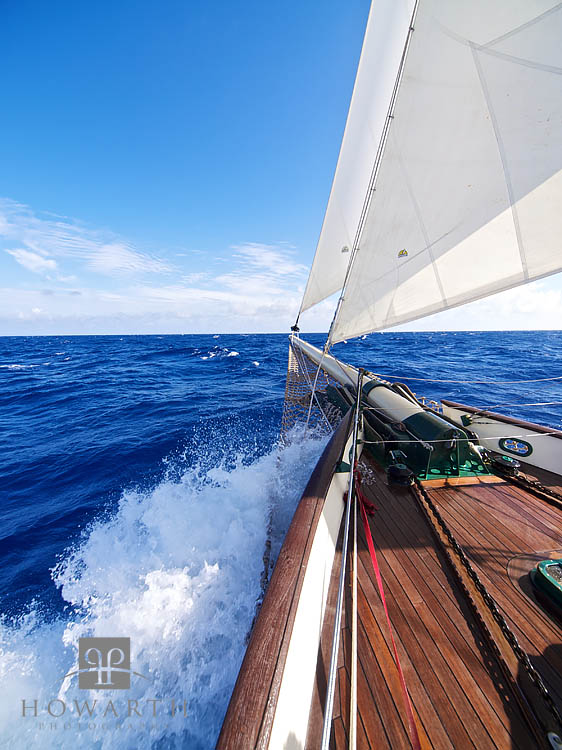 Pushing North through the Atlantic under full sail with the blue skies and deep blue sea