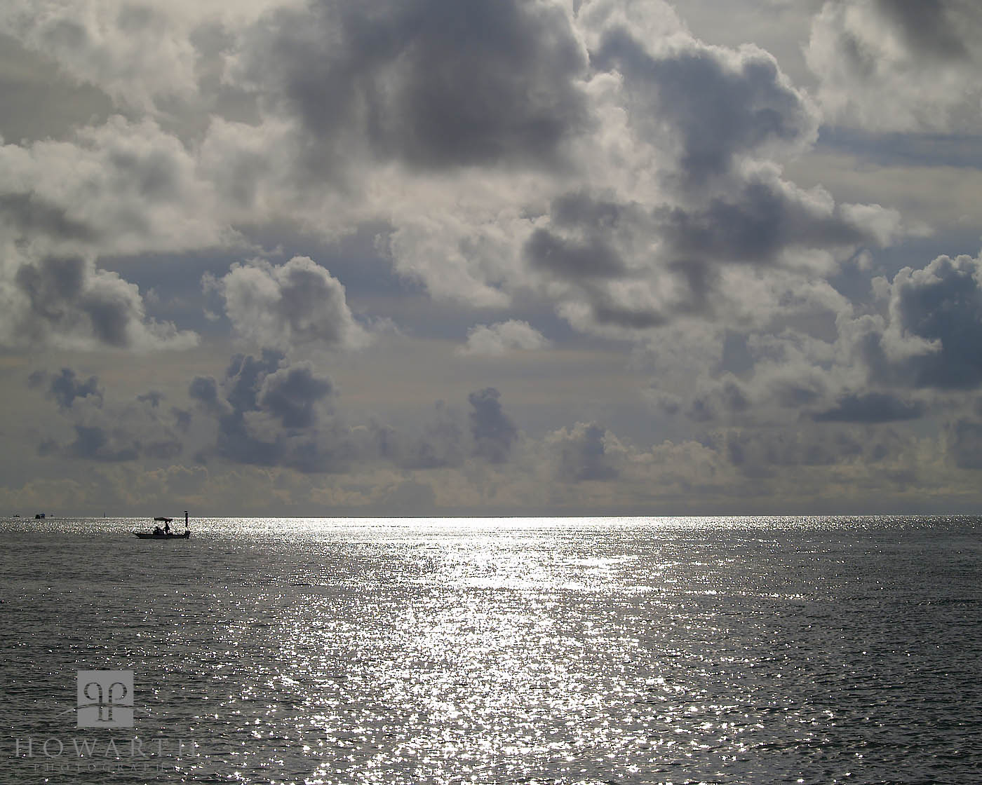 The bright sun late in the afternoon looking offshore