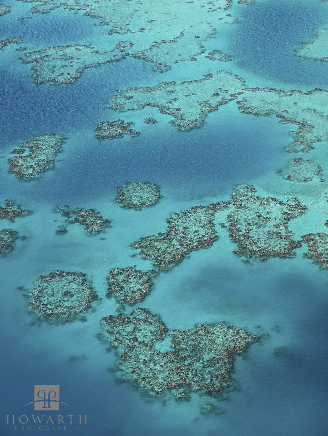 A cluster of reef just off the West side, turquoise waters