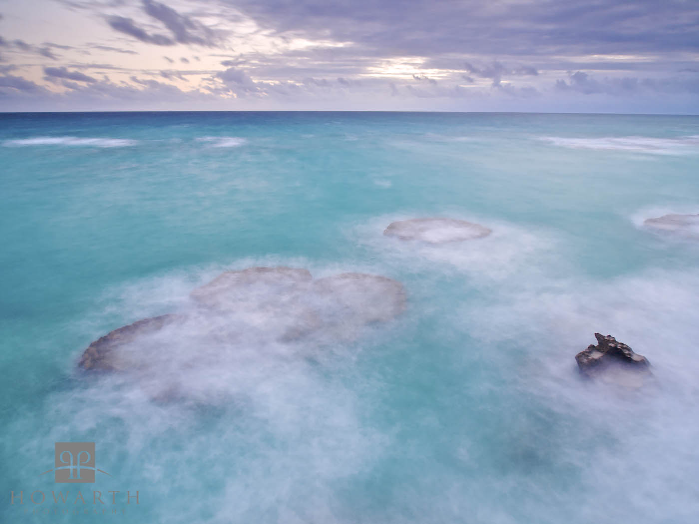 A long exposure smoothes the turbulent water covering the reef